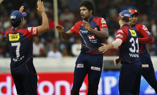 Delhi Daredevils bowler Varun Aaron, center, celebrates the wicket of Deccan Chargers\' Kumar...