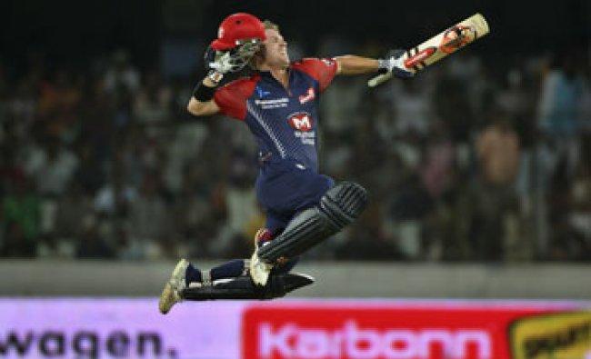 Delhi Daredevils David Warner celebrates his century against Deccan Chargers in Hyderabad...