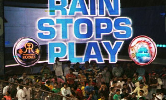 Fans wait as it rains during the match between Rajasthan Royals and Chennai Super Kings...