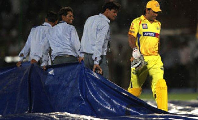 Chennai Super Kings\' MS Dhoni leaves the ground as it rains over the Sawai Mansingh Stadium...