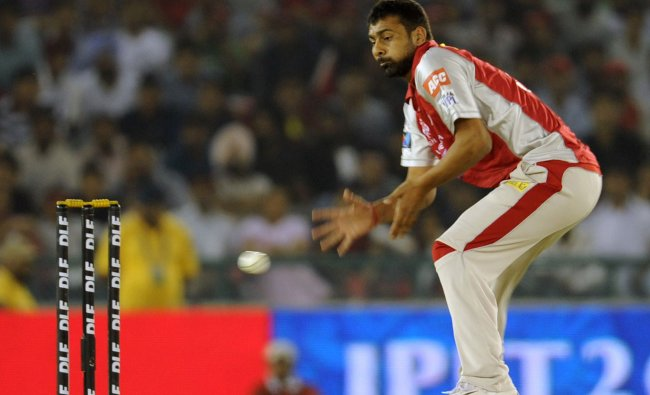 Praveen Kumar receives a throw during the Twenty20 match between Kings XI Punjab and Deccan Chargers