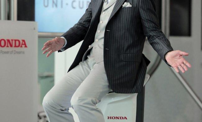 Former Space Shuttle Endeavour mission specialist Mamoru Mohri demonstrates Honda Motor ...
