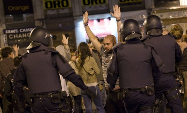Demonstrators are evicted by riot police at Puerta del Sol square
