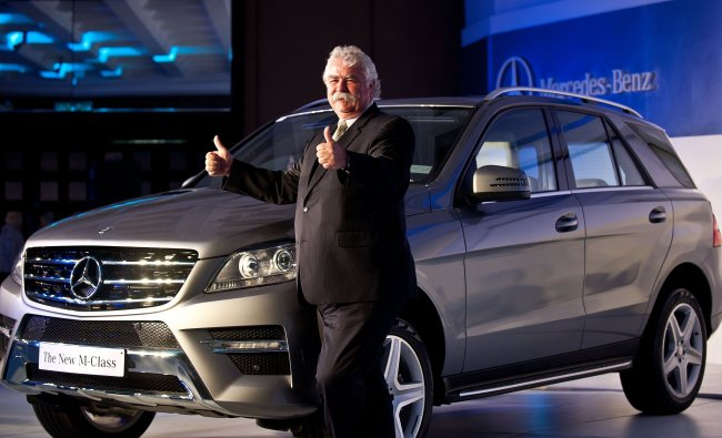 Peter Honegg gestures while posing with the new edition Mercedes-Benz M-class SUV car