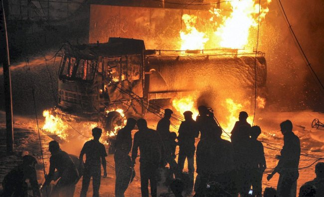 Fire fighters trying to extinguish fire at a petrol pump in Ranchi on Monday night.
