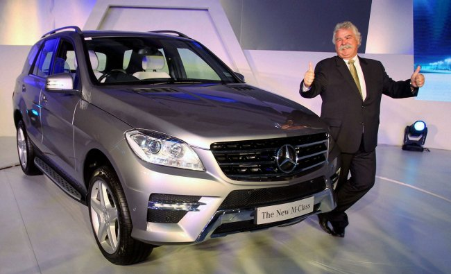 Peter Honegg, Managing Director and CEO, Mercedes-Benz India, posing with the newly introduced...