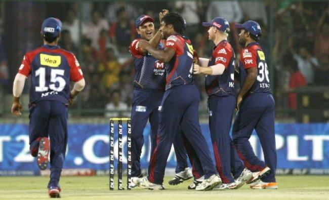 Delhi Daredevils\' captain Virender Sehwag, second left, along with teammates...