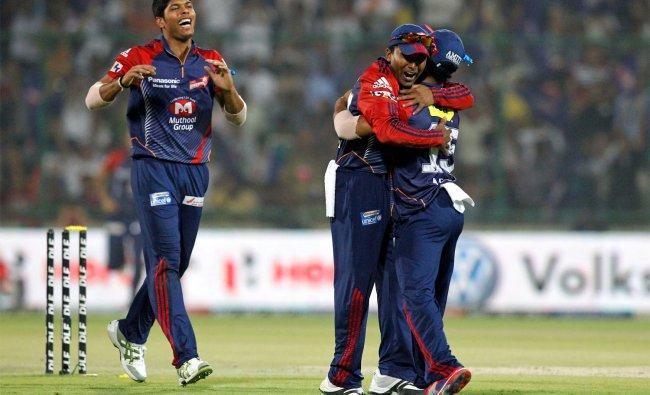 Mahela Jayawardene, center, and teammates celebrate the dismissal of Kings XI Punjab\'s David Miller