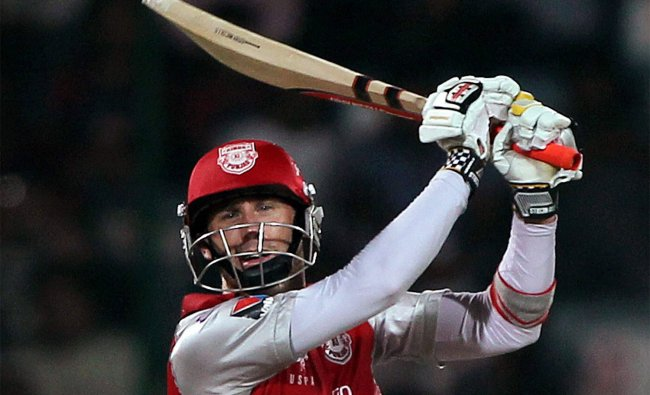 David Hussey plays a shot against Delhi Daredevils during their IPL-5 match