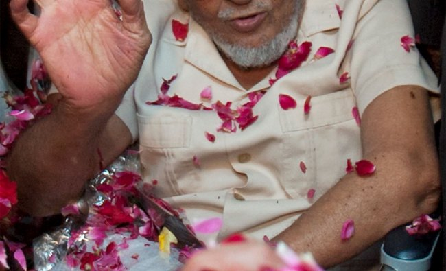 Released Pakistani scientist Mohammad Khalil Chisti is welcomed on his arrival in Pakistan