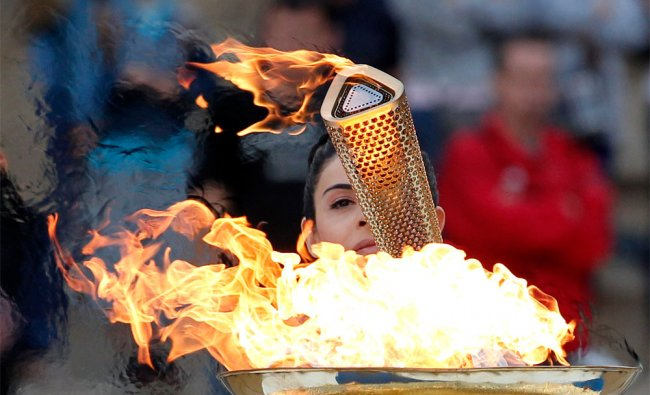 Actress Ino Menegaki, dressed as a high priestess, lights the torch at a ceremony in Athens