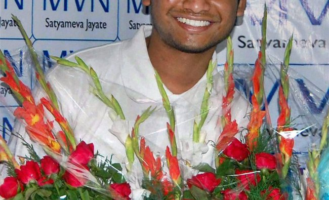 All India IIT-JEE topper Arpit Aggarwal celebrates his success at his school in Faridabad
