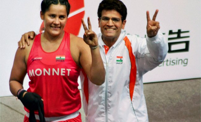 Boxer Kavita Chahal flashes victory sign after defeating Semsi Yarali of Turkey