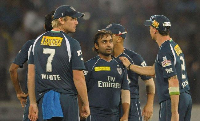 Amit Mishra (C) is congratulated after taking the wicket of Rajasthan Royals batsman Stuart Binny