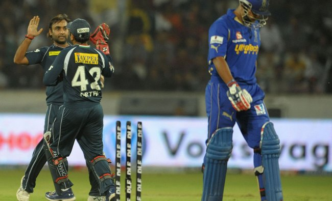 Amit Mishra (L) celebrates taking the wicket of Rajasthan Royals batsman Stuart Binny