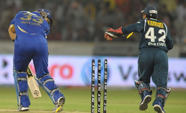 Shane Watson (L) is bowled by Deccan Chargers\' Amit Mishra