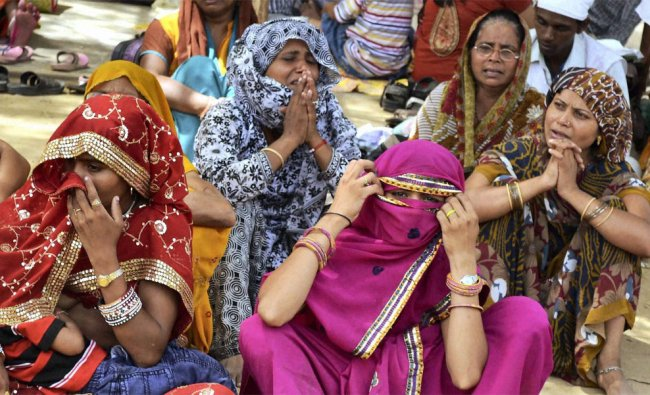 Women followers gather to pay their last respect to the mortal remains of Spiritual guru Jai Gurudev