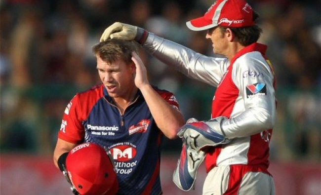 Kings XI Punjab captain Adam Gilchrist looks at the injury...
