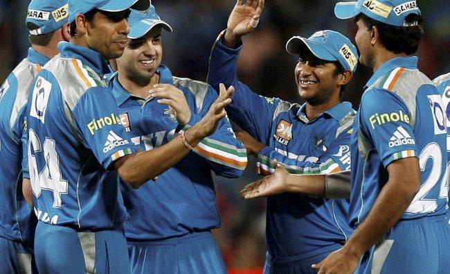 Pune Warriors players celebrate the dismissal of Kolkata Knight Riders batsman Gautam Gambhir ...