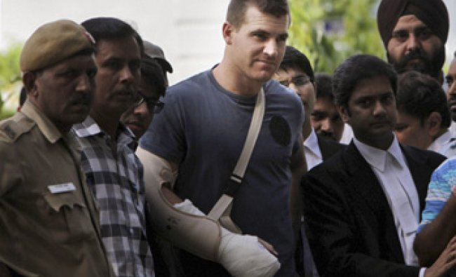 Cricketer Luke Pomersbach comes out of a court after being granted bail in New Delhi...