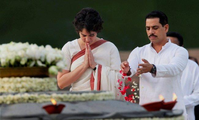 Priyanka Vadra with her husband Robert Vadra paying tribute to former Prime Minister Rajiv Gandhi...