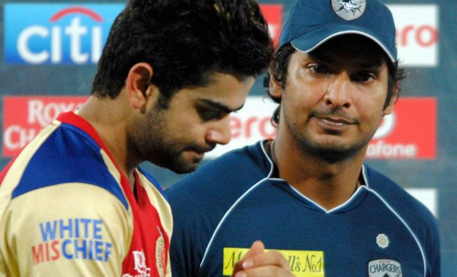 Royal Challengers Bangalore\'s captain Virat Kohli looks dejected as he stands with Deccan...