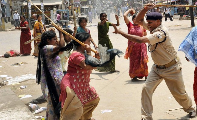Police lathi-charge a group of women during a protest in Patna...