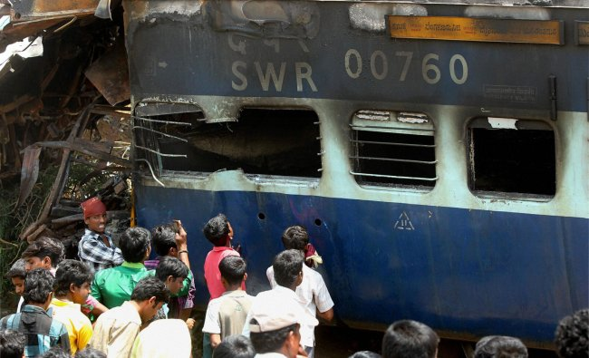 Rescue work on full swing at the accident site after the Hampi Express rammed into the rear of a...
