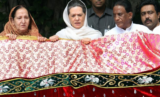 UPA Chairperson Sonia Gandhi holding a \'chadar\' before sending it for the shrine of Khwaja...