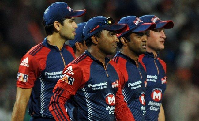 Delhi Daredevils cricketers watch the dismissal of Gautam Gambhir...