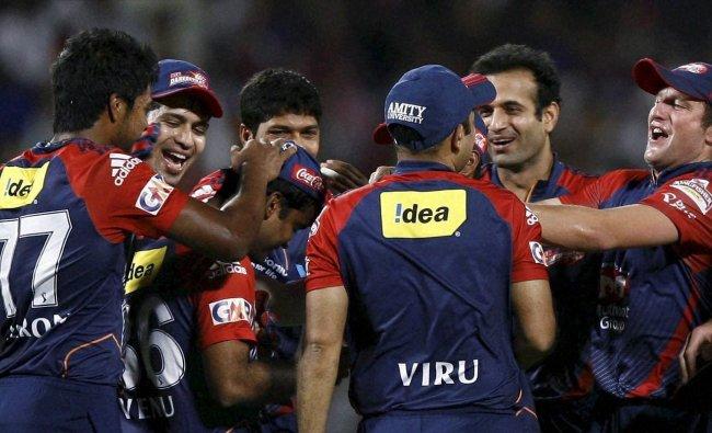 Delhi Daredevils players celebrate the dismissal of Kolkata Knight Riders Gautam Gambhir ...