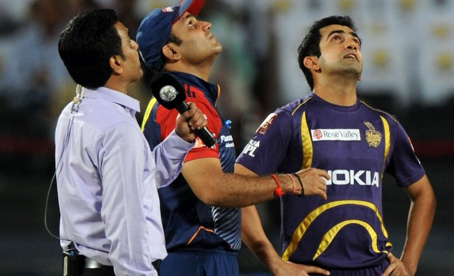 Virender Sehwag and Gautam Gambhir look skywards during the coin toss...