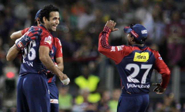 Delhi Daredevils Irfan Pathan, left, celebrates the wicket of KKR batsman Shakib Al Hasan...