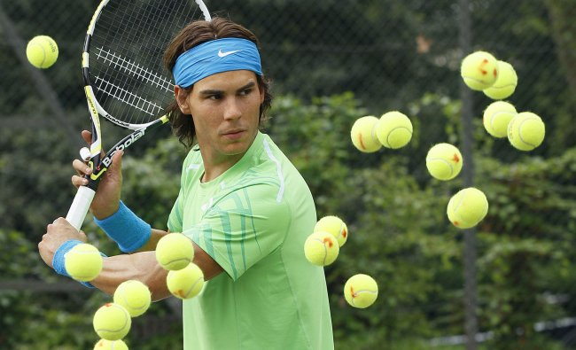 A model of Rafael Nadal is surrounded by tennis balls at a tennis centre in Regents Park in...