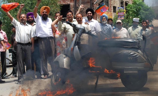 BJP activists protest against petrol price hike in Amritsar...