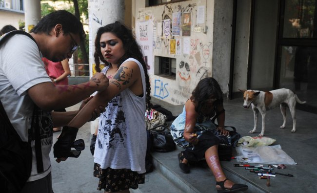 Students and social activists put on make-up prior to particiapting in a \