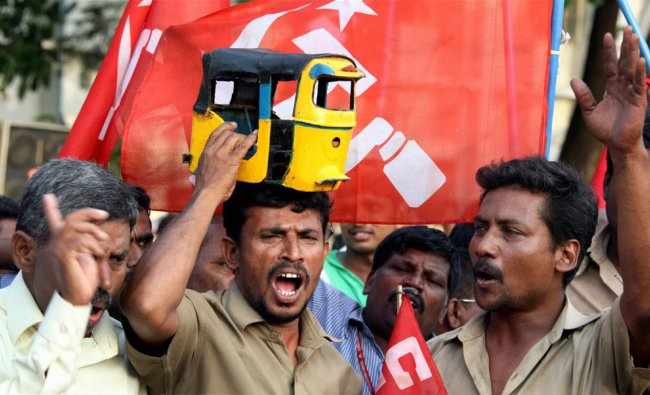 CPI(M) workers raise slogans during a protest against the UPA government over petrol price hike ...