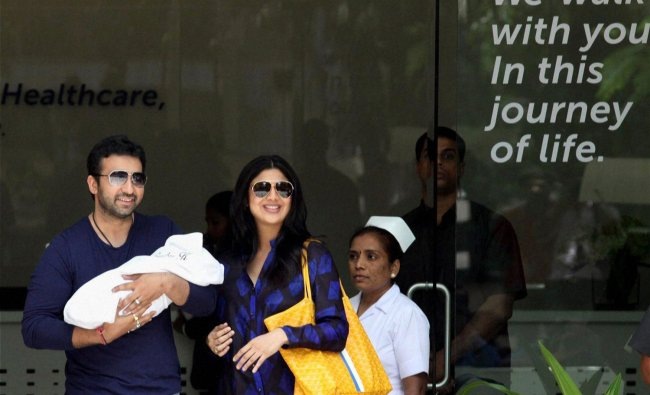 Bollywood actress Shilpa Shetty with her husband Raj Kundra after she was discharged from...
