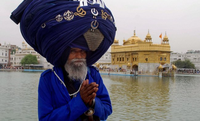 A Nihang (Sikh warrior) paying obeisance at the Golden Temple...