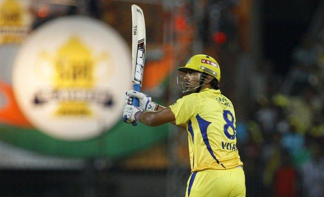 Chennai Super Kings\' batsman Murali Vijay watches his shot against Delhi...