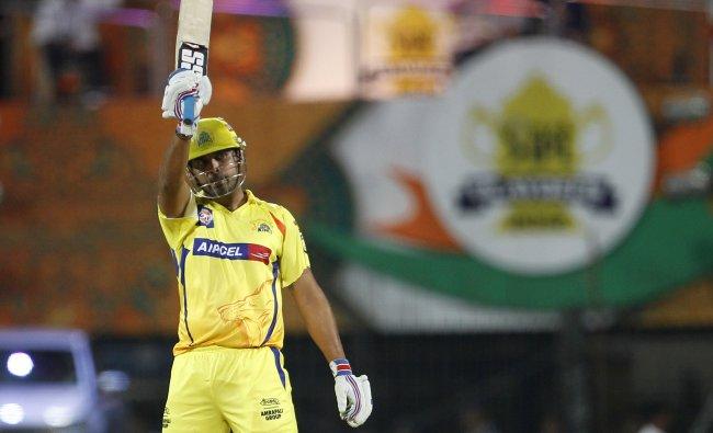 Chennai Super Kings\' batsman Murali Vijay raises his bat to celebrate scoring a half century...