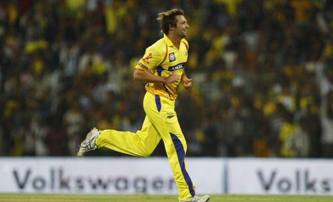 Chennai Super Kings\' bowler Ben Hilfenhaus celebrates the dismissal of David Warner...