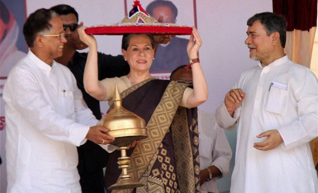 Sonia Gandhi being presented with a traditional Assamese \'Japi\' at an event in Assam