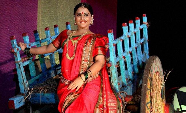 Vidya Balan poses for photographs at a promotional event