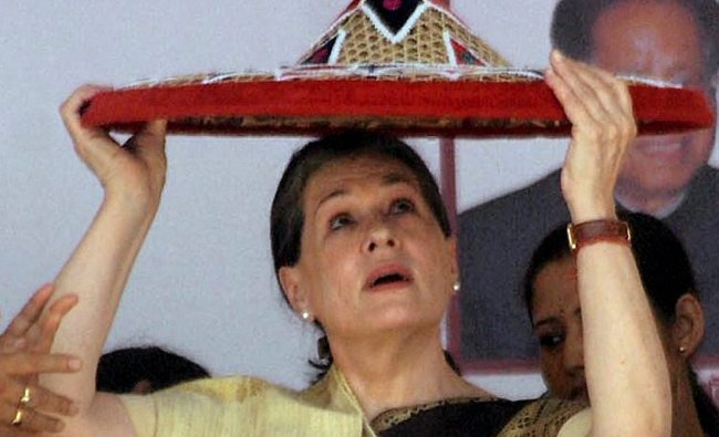 UPA Chairperson Sonia Gandhi is presented with a traditional Assamese \'Japi\'