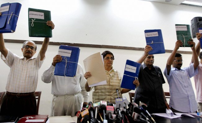 Team Anna members display files containing evidence of corruption against 15 ministers