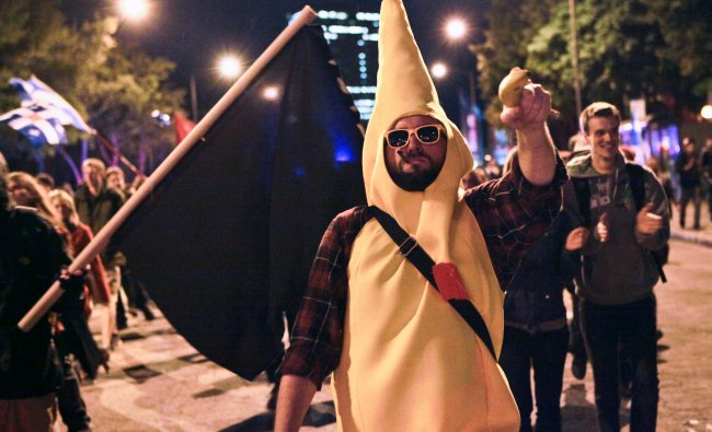 A man dressed as a banana takes part in a protest in Quebec City