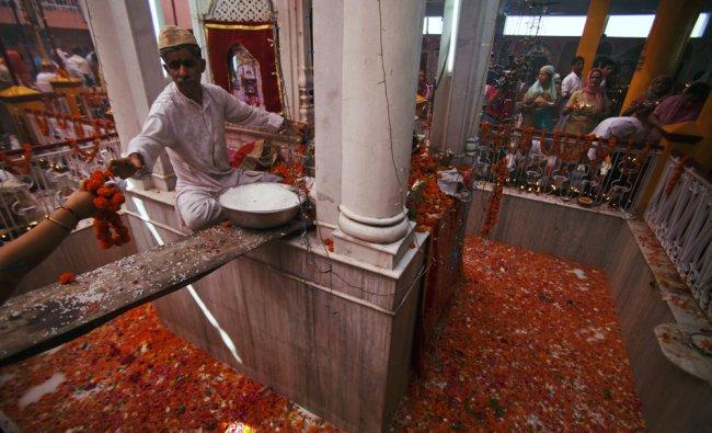 Kashmiri Pandits perform rituals at the Kheer Bhawani temple during an annual Hindu festival...