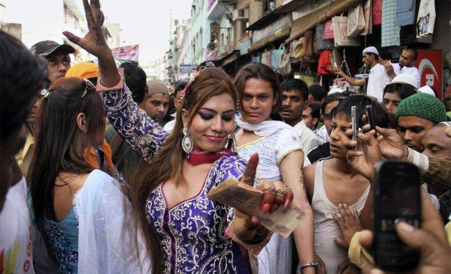 Eunuchs dance in the streets during annual Urs of sufi saint Khwaja Moinuddin Chishti