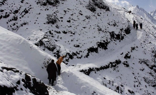 Snow-covered mountain tracks leading to the Amarnath cave shrine seen in Baltal